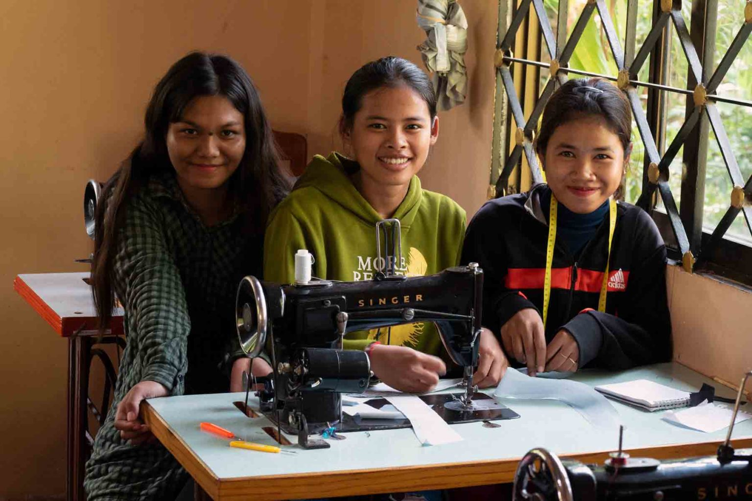 Young Cambodian girls studying fashion design and sewing at a training center in Battambang, Cambodia.
